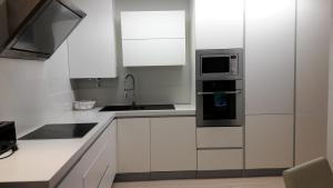 A kitchen or kitchenette at Atlantico Village Apartment