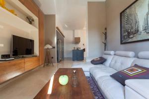 A seating area at Apartamento San Fernando