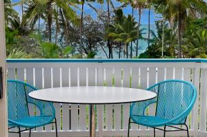 A balcony or terrace at By The Sea Port Douglas