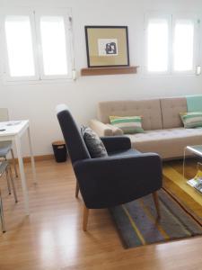 Ein Sitzbereich in der Unterkunft Apartment Callao