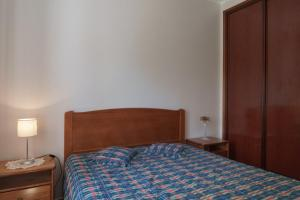 A bed or beds in a room at Akivillas Carvoeiro Relax