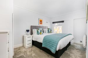 Krevet ili kreveti u jedinici u okviru objekta Camden Serviced Apartments