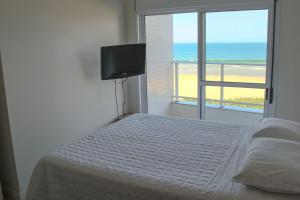 A bed or beds in a room at Aquarelle Ingleses