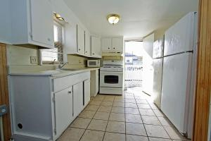 A kitchen or kitchenette at Shore Beach Houses - 119 F Franklin Avenue