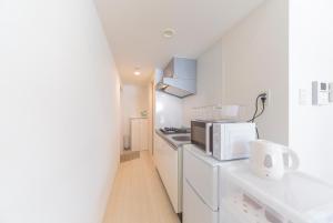 TRIP POD MINOSHIMA -room-にあるキッチンまたは簡易キッチン