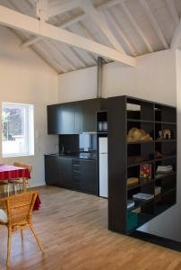 A television and/or entertainment center at Serralves Loft