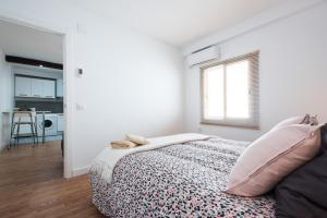 A bed or beds in a room at Apartamento Monsalves