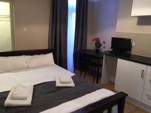 Posteľ alebo postele v izbe v ubytovaní Mora Apartments