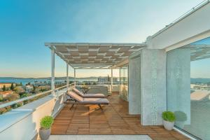 The swimming pool at or close to Sunset Penthouse Apartment With Jacuzzi