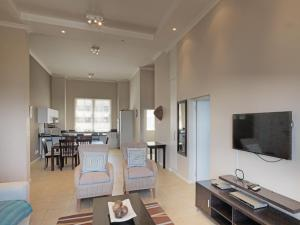 A television and/or entertainment center at Surferscorner Self Catering Apartments