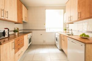 A kitchen or kitchenette at Apartamento Living Santa Ana