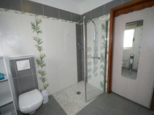 A bathroom at Modern Holiday Home with jacuzzi in Brousse-le-Chateau