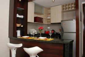 Una cocina o zona de cocina en Puerta Arauco Apartamentos