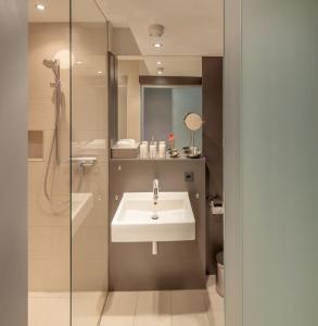 A bathroom at Stadtbleibe Apartments