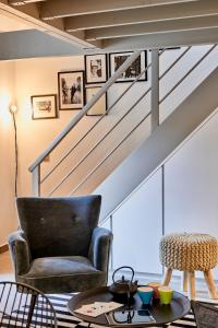 Uma área de estar em My Maison In Paris - Sentier