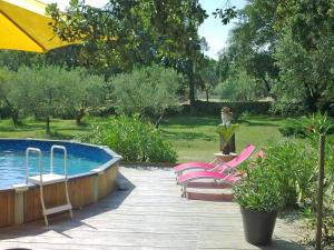 The swimming pool at or near Antique Holiday Home with Swimming Pool in L'Isle-sur-la-Sorgue