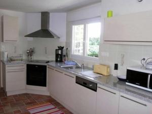 A kitchen or kitchenette at Warm Holiday Home at Plozevet Brittany with Lawn