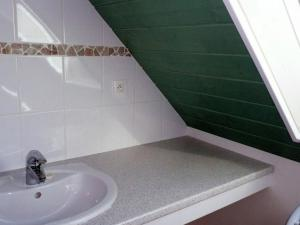 A bathroom at Warm Holiday Home at Plozevet Brittany with Lawn