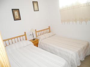 Cama o camas de una habitación en Apartamentos Benafer