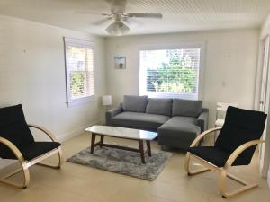 A seating area at Gorgeous Beach House Across The Street From The Beach! Kayaks, Bikes, Etc...