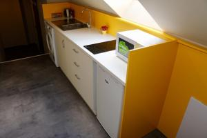Kuchyňa alebo kuchynka v ubytovaní Cassovia Apartments