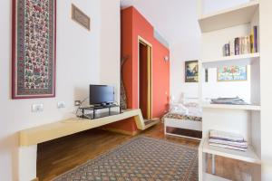 A television and/or entertainment center at Self Catering Studio on Poetto beach