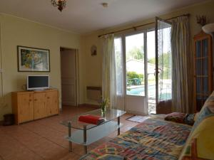 A television and/or entertainment center at Cozy Holiday Home in Souvigne with Private Pool