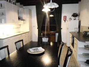 A kitchen or kitchenette at Heritage holiday home in Vieure with Garden