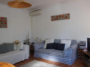 A seating area at Charming Holiday Home in Regusse, Provence with Terrace