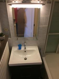 Salle de bains dans l'établissement Residentie Maria Lucia