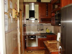 A kitchen or kitchenette at Pokoje Gościnne Vera