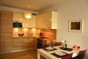 Kuchnia lub aneks kuchenny w obiekcie Apartament Solna 106
