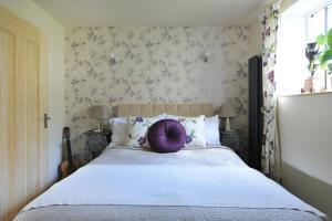 Llit o llits en una habitació de Kensington Court