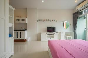 A kitchen or kitchenette at The Bell Condo Chalong Phuket