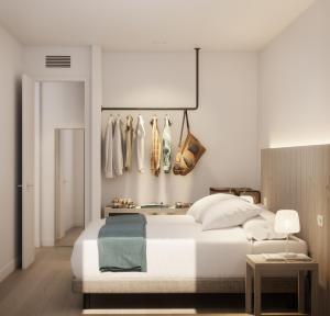 Un ou plusieurs lits dans un hébergement de l'établissement White Apartments - Adults Only