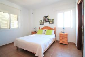 A bed or beds in a room at Villa Sofia