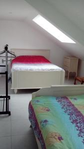 Un ou plusieurs lits dans un hébergement de l'établissement Gîte de Blessy