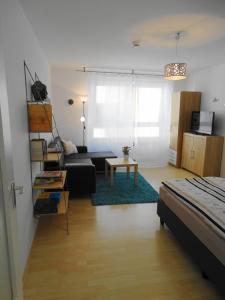 Ein Sitzbereich in der Unterkunft Apartment Haugerkirchgasse