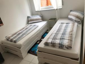 Ein Bett oder Betten in einem Zimmer der Unterkunft Ferienwohnung Hutzfeld