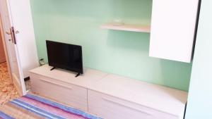 A television and/or entertainment center at Edolo Apartment