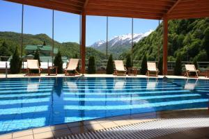 The swimming pool at or near Grand Hotel Polyana Villas