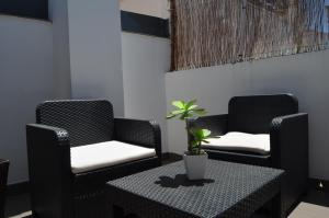 A seating area at Apartamentos San Pablo