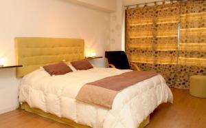 Una cama o camas en una habitación de Alquilar En Bariloche