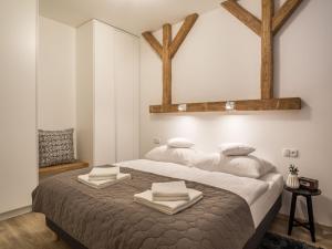 Łóżko lub łóżka w pokoju w obiekcie TatryTop Nellin Granitica