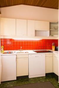 Küche/Küchenzeile in der Unterkunft Rodlers Chalet