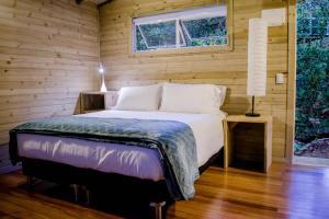 Un ou plusieurs lits dans un hébergement de l'établissement Monte Helicon Ecolodge and Spa