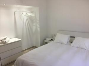 A bed or beds in a room at 3C Fuerteventura Jardín del Río