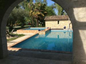 The swimming pool at or near Gîte Le Bois de Montpouillan