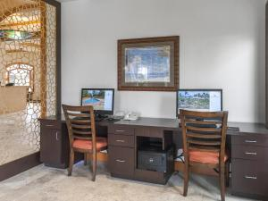 A television and/or entertainment center at The Point at Poipu By Diamond Resorts