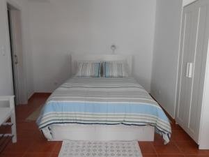 A bed or beds in a room at Studio Bibi